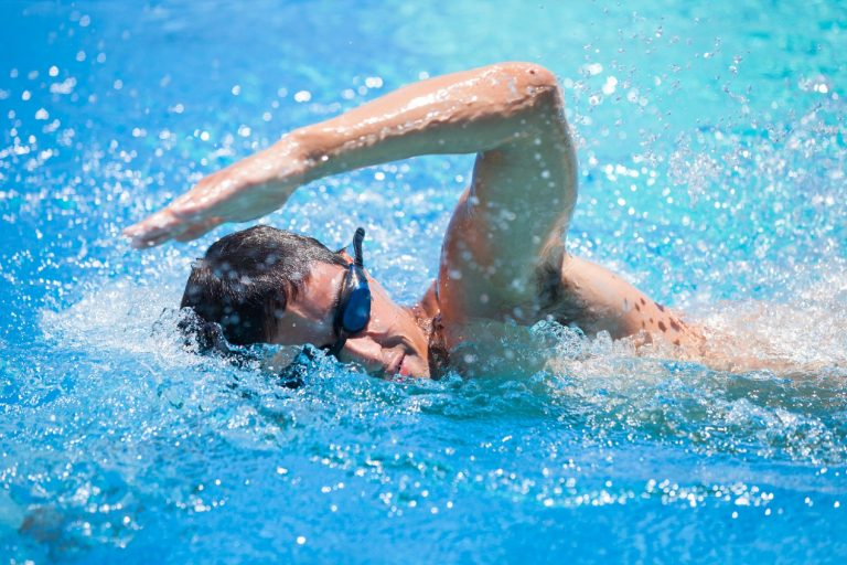 Professional swimmer doing crawl