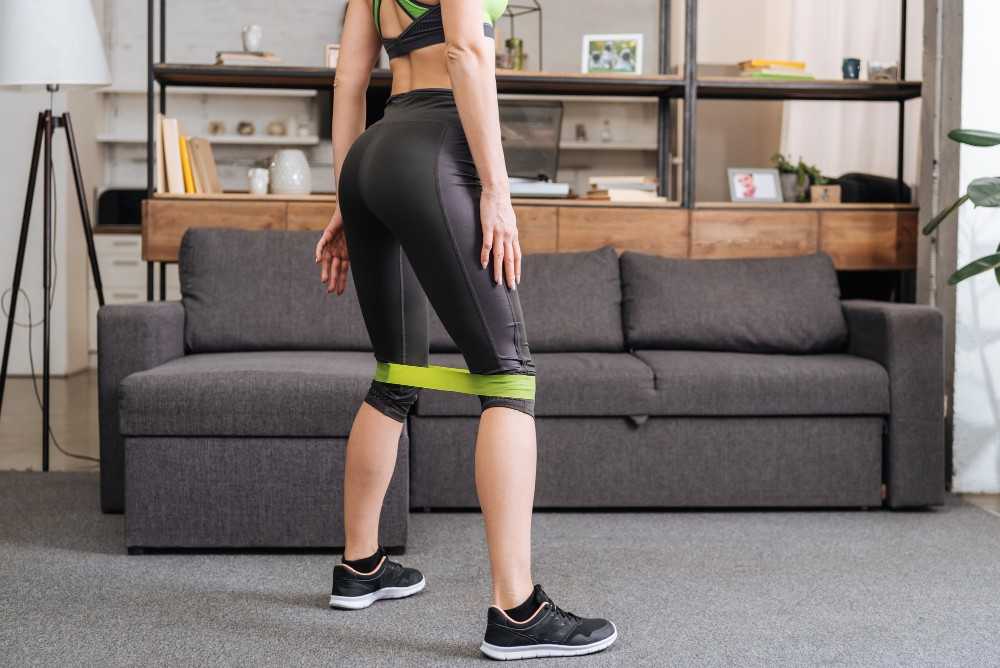 Woman using resistance bands for her workout at home