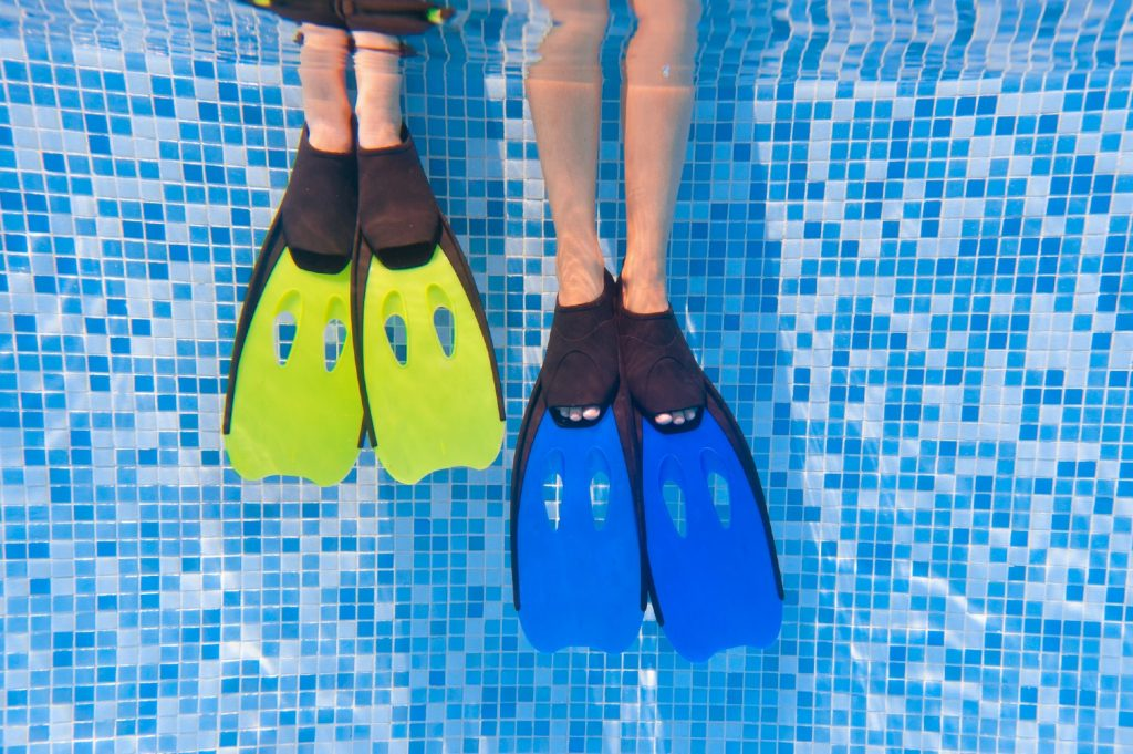 Two persons with their legs in the water