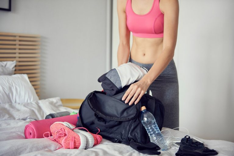 Woman packing her outfit for the gym