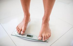 Woman with bare feet on a bathroom scale