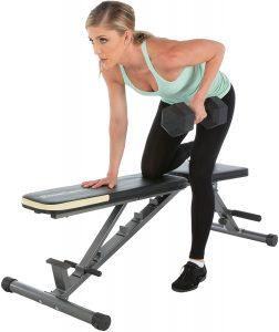 Woman exercising on a weight bench